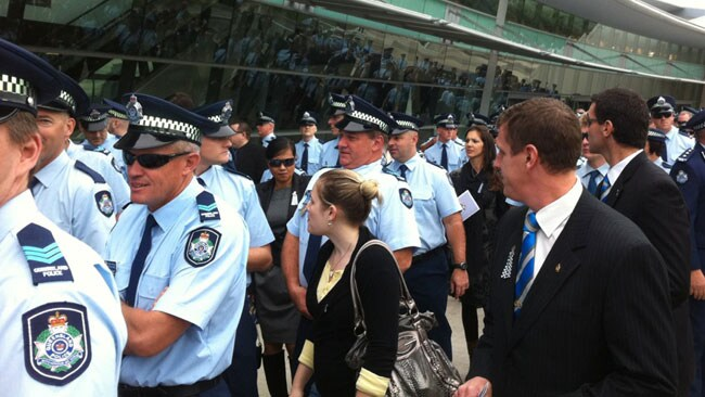Hundreds of police officers have joined thousands at the funeral for slain policeman Damian Leeding on the Gold Coast. Picture: Brooke Baskin