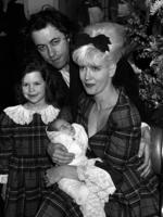 Bob Geldof's daughter has been found dead at her UK home. In this March 16, 1989 file photo Bob, his late wife, TV presenter Paula Yates, right, and their five-year-old daughter Fifi Trixiebelle, left, show off the new addition to their family, an as yet unnamed baby girl, later named Peaches, at St Mary's Hospital in Paddington, London. Picture: AP Photo/PA, Martin Keene, File