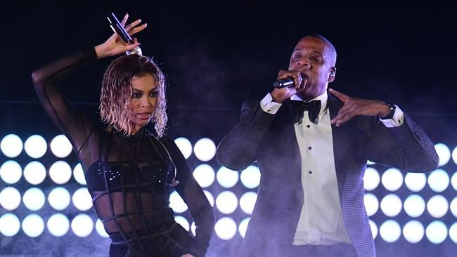 Beyoncé Knowles and Jay-Z perform on stage for the 56th Grammy Awards. AFP PHOTO FREDERIC J. BROWN