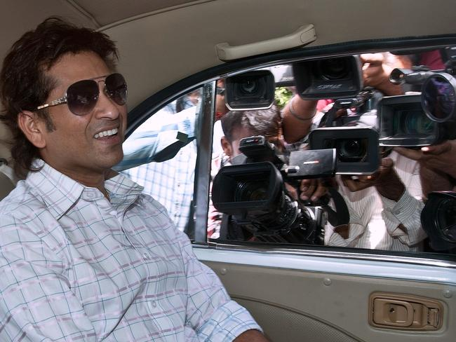 Sachin Tendulkar is besieged by the media as he arrives at Parliament House in Delhi in 2012.