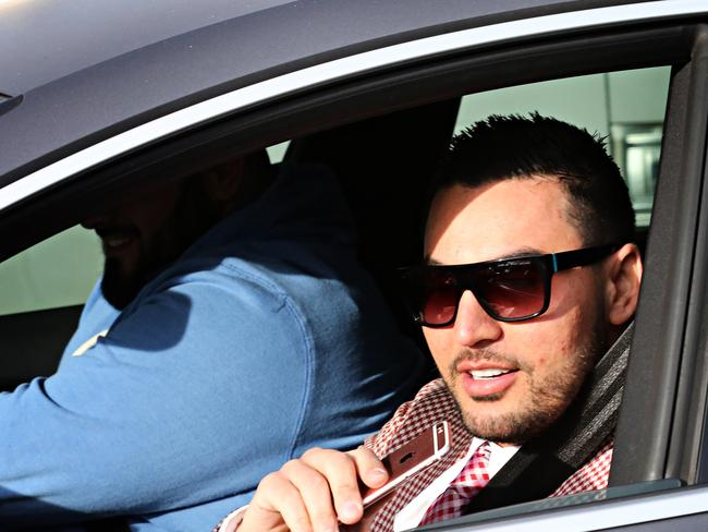 Mehajer leaving his house in Lidcombe in July.