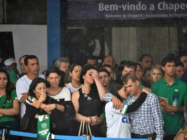 Relatives of the members of the team await their arrival at Chapeco airport in southern Brazil. Picture: AFP/Nelson Almeida