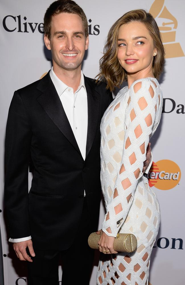 Co-founder and CEO of Snapchat Evan Spiegel with girlfriend Miranda Kerr who is wearing a wing on her wedding finger that sources claim is not an engagement ring. Picture: Getty Images