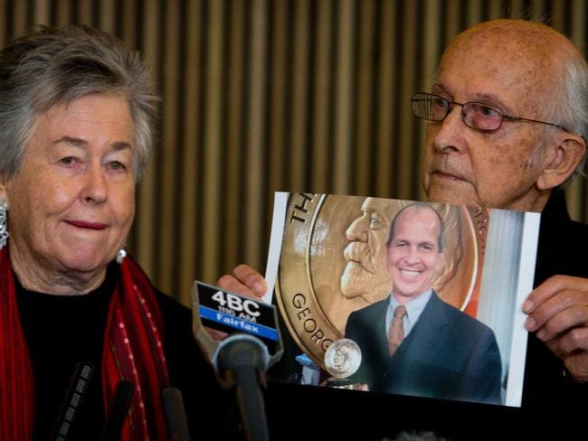Shocked ... Juris Greste (right) displays a picture of his son, jailed Australian Al-Jazeera journalist Peter Greste, next to his wife Lois (left) during a press conference in Brisbane. Picture: AFP
