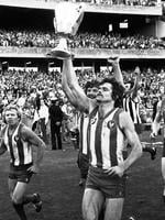 David Dench with the cup after the Kangaroos won the 1977 Grand Final.