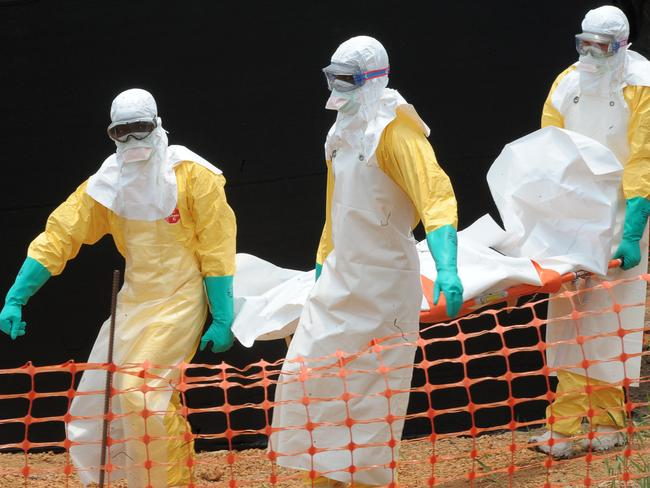 Deadly toll ... Staff of the 'Doctors without Borders' ('Medecin sans frontieres') medical aid organisation carry the body of a person killed by Ebola, at a centre for victims in Guekedou. Pic: AFP PHOTO/SEYLLOU