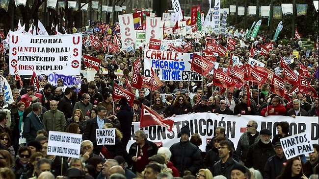 Demonstrators march during a protest against unemployment and austerity measures in Madrid, Spain. Picture: AP