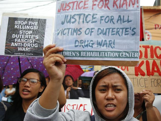 Protesters march ahead of the wake for slain Kian Loyd delos Santos. Picture: Bullit Marquez