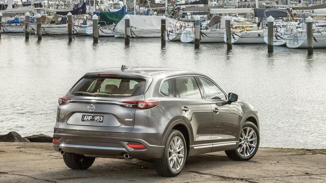 CX-9 Azami: Space-saver spare plus compromised luggage space with third-row seats in use.