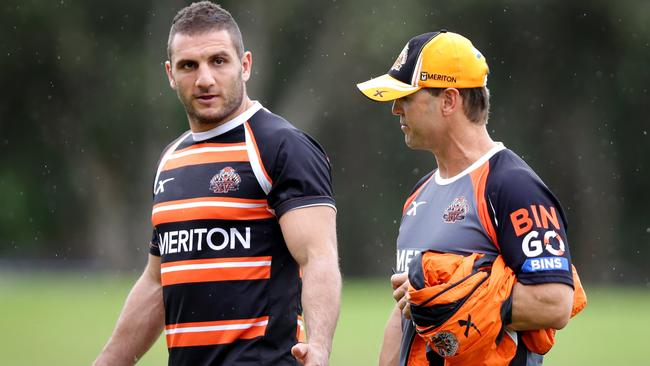Tiger's Robbie Farah and coach Mick Potter.