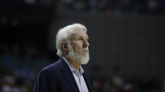 San Antonio Spurs head coach Gregg Popovich watches the game against Phoenix in the first half of their regular-season NBA basketball game in Mexico City, Saturday, Jan. 14, 2017. (AP Photo/Rebecca Blackwell)