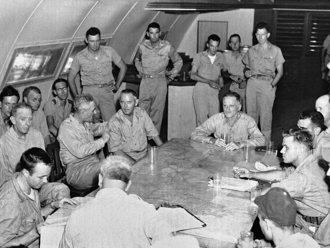 A file photo from the US army shows the Enola Gay crew after dropping the bomb. At foreground left, seated at the corner of the table, is Capt. Thodore VanKirk, navigator. Pic: AP.
