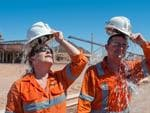 Oz Minerals workers Tammy Jackson-Rothe and Andrew Graziani keep cool in the Far North. Picture: Chris Warrior