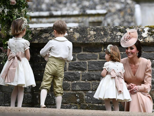 Kate stands with her daughter princess Charlotte after leaving the church.