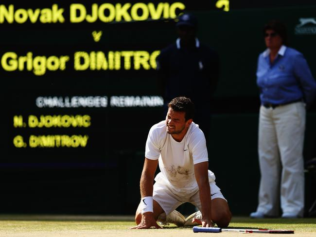 Grigor Dimitrov down on his knees.