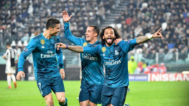 Real Madrid's Brazilian defender Marcelo (R) celebrates after scoring with Real Madrid's Spanish midfielder Lucas Vazquez and Real Madrid's Portuguese forward Cristiano Ronaldo (L)