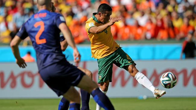 Tim Cahill of Australia shoots and scores his team's first goal.