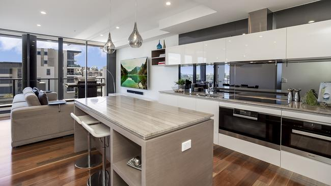 The modern kitchen offers unique stone benchtops and quality appliances