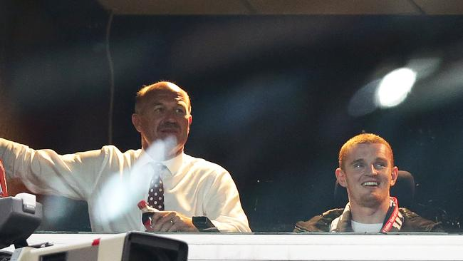 Wally Lewis and Alex McKinnon have a chat at Wednesday's Origin encounter. Picture Gregg Porteous