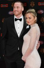 Hawthorn player Jarryd Roughead and his wife Sarah pose for photos on arrival at the Brownlow medal ceremony at Crown in Melbourne, Monday, September 25, 2017. Picture: AAP Image/Julian Smith