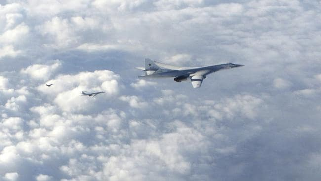 Two Russian Blackjack Tupolev Tu-160 long-range bombers are followed by an RAF Typhoon aircraft, left, scrambled from RAF Lossiemouth, Scotland. Picture: Royal Air Force via AP.