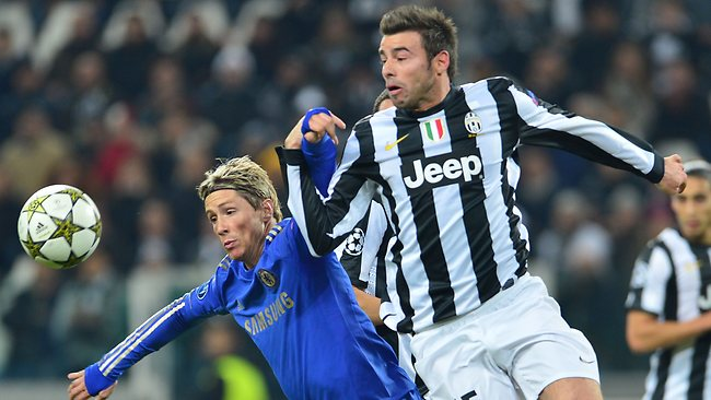 Chelsea's Spanish striker Fernando Torres, left, challanges for the ball with Juventus' defender Andrea Barzagli.