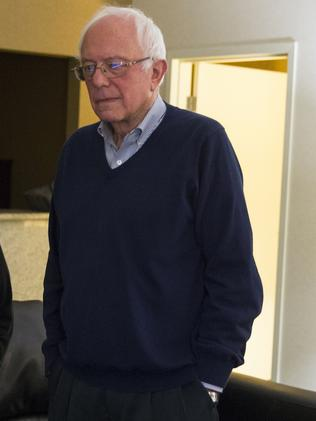 Democratic presidential candidate Bernie Sanders watches caucus returns in his hotel room. Picture: AP
