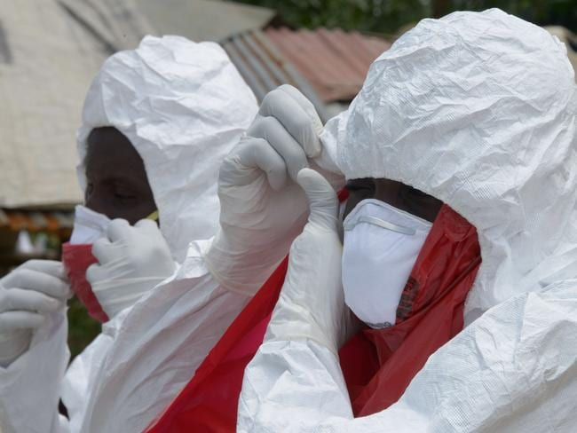 Frontline workers ... the key to controlling the Ebola outbreak is manpower and medical basics. Picture: Dominique Faget