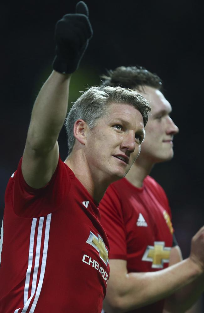 Manchester United's Bastian Schweinsteiger waves to the crowd.
