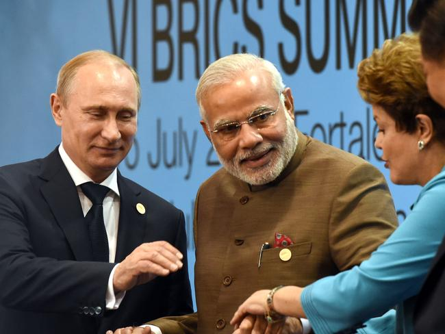 The leaders of Russia, India and Brazil may look happy here but their countries are experiencing slow growth.