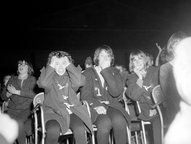 Many of their screaming fans struggled with their emotions at the band's Melbourne concerts. Picture: Herald Sun Image Library