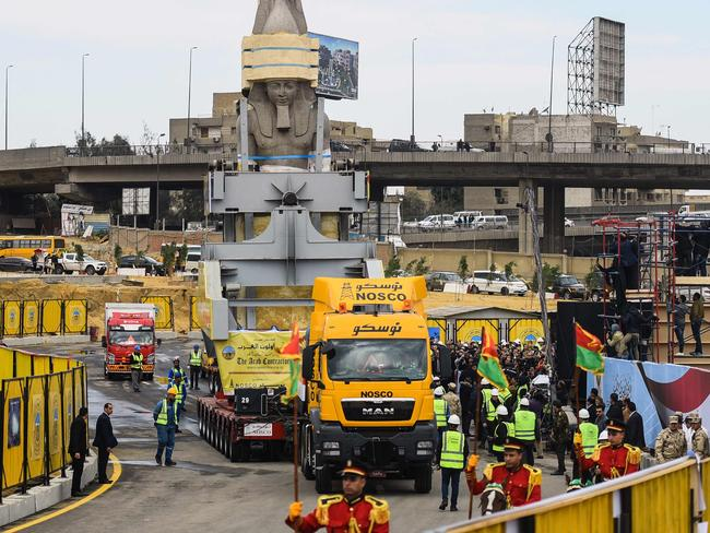 The 3200-year-old colossal statue of King Ramses II during its transfer to the main entrance of the Grand Egyptian Museum in Cairo's twin city Giza. Picture: AFP Photo/Mohamed El-Shahed