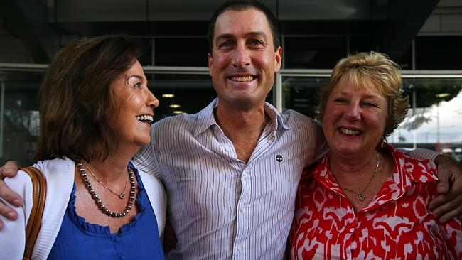 Marcus Lee is hugged by Rosmary Adams (left) and mum Carol McKinley (right) arriving at Sydney International Airport this morning. Pic: Sam Mooy