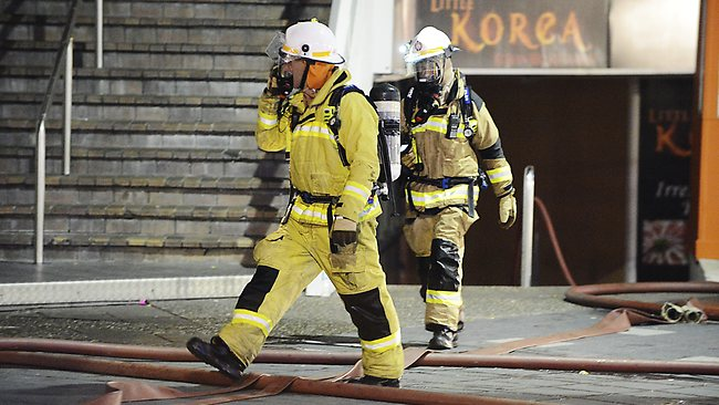 Firefighters assess the aftermath of an electrical fire in Shooters nightclub in Surfers Paradise. Picture: Jason Edwards