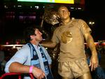 Former NSW star Bryan Fletcher stands next to former fellow Blues star Nathan Hindmarsh and poses as a statue in front of the statue of Wally Lewis at Suncorp Stadium.