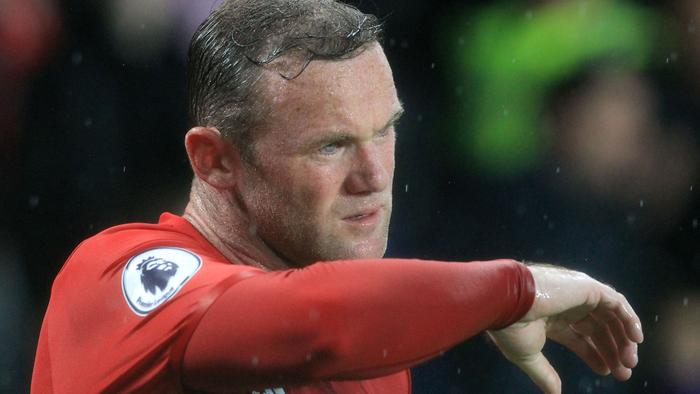 Manchester United's English striker Wayne Rooney gestures during the English Premier League football match between Hull City and Manchester United at the KCOM Stadium in Kingston upon Hull, north east England on August 27, 2016. Manchester united won the game 1-0. / AFP PHOTO / Lindsey PARNABY / RESTRICTED TO EDITORIAL USE. No use with unauthorized audio, video, data, fixture lists, club/league logos or 'live' services. Online in-match use limited to 75 images, no video emulation. No use in betting, games or single club/league/player publications. /