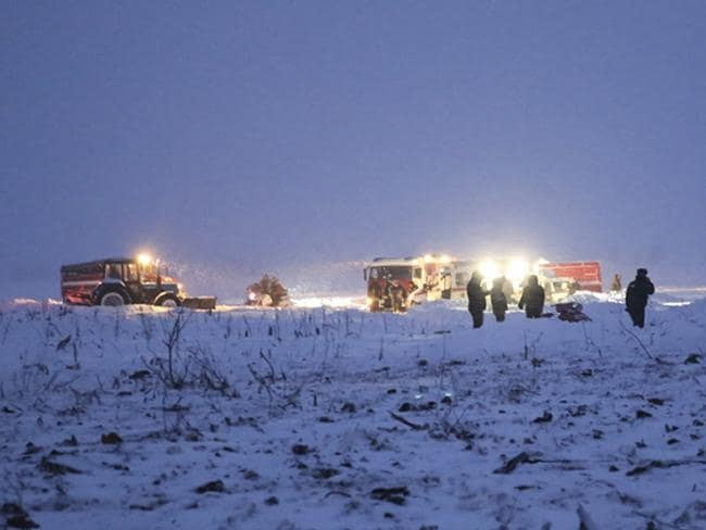 Russian Ministry for Emergency Situations employees work at the scene of a AN-148 plane crash about 40 kilometres from the Domodedovo airport. Picture: AP
