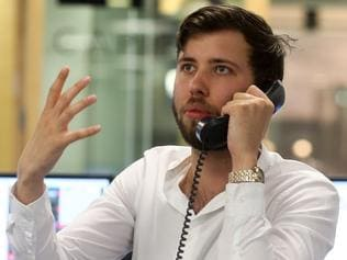 "A trader speaks on a fixed line telephone at ETX Capital, a broker of contracts-for-difference, in London, U.K. on Thursday, June 23, 2016. The pound headed for its biggest-ever drop, leading a decline in U.K. assets, as early results in Britain's European Union referendum pointed to a potential victory for the ""Leave"" campaign. Photographer: Chris Ratcliffe/Bloomberg via Getty Images"