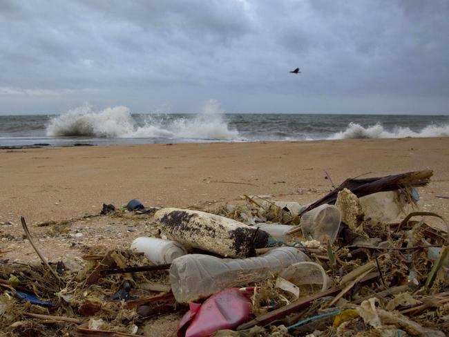 A plastic bottle lies among other debris washed ashore on the Indian Ocean beach in Uswetakeiyawa, north of Colombo, Sri Lanka. Picture: Gemunu Amarasinghe