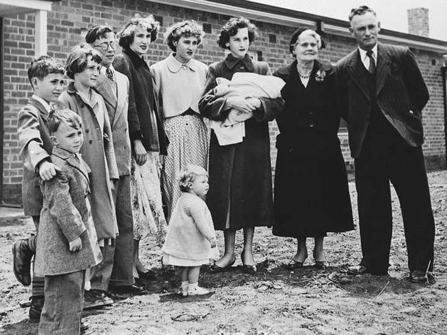Mr Raymond Leslie Pinnegar, the Housing Trust's first tenant in Elizabeth, with members of his family outside their new home at 10 Bubner Street, Elizabeth South, November 1955. Source: State Library of SA.