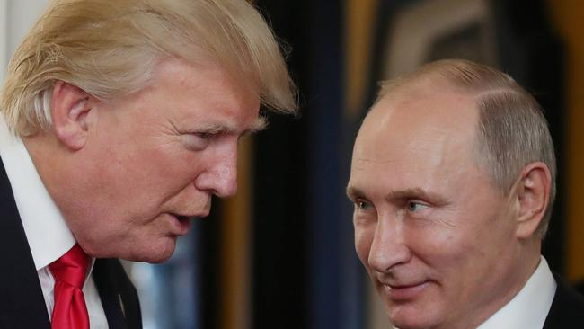 US President Donald Trump and Russian President Vladimir Putin at the APEC Meeting last year. Picture: AFP/Mikhail Klimentyev