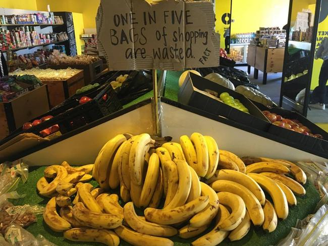 """""""One in five bags of shopping are wasted,"""" a sign reads."""