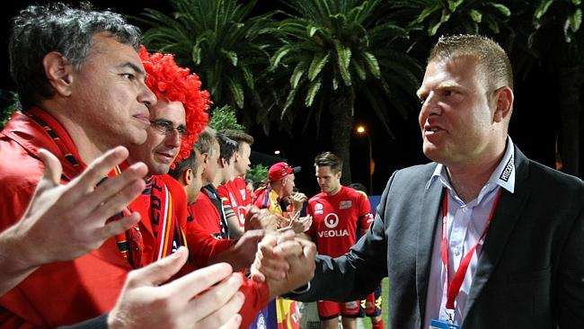 Adelaide United coach Josep Gombau with fans after the loss to Central Coast Mariners. Picture: Tony Feder.