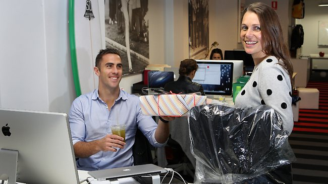 Jenni Harrison from Mr Cornelius delivers some goodies to client Nick Smith. Picture: Andrew Tauber