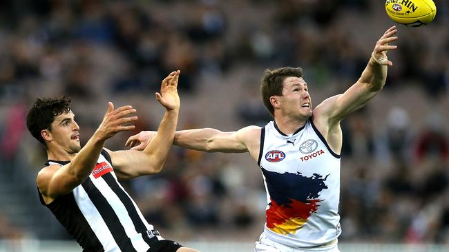 Patrick Dangerfield holds off Scott Pendlebury. Picture: Wayne Ludbey