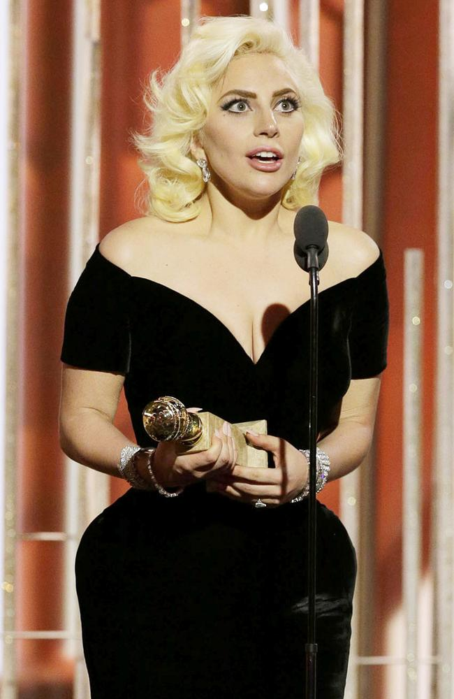 "Lady Gaga accepts the award for Best Actress - Limited Series or TV Movie for ""American Horror Story: Hotel"" during the 73rd Annual Golden Globe Awards at The Beverly Hilton Hotel on January 10, 2016 in Beverly Hills, California. (Photo by Paul Drinkwater/NBCUniversal via Getty Images)"