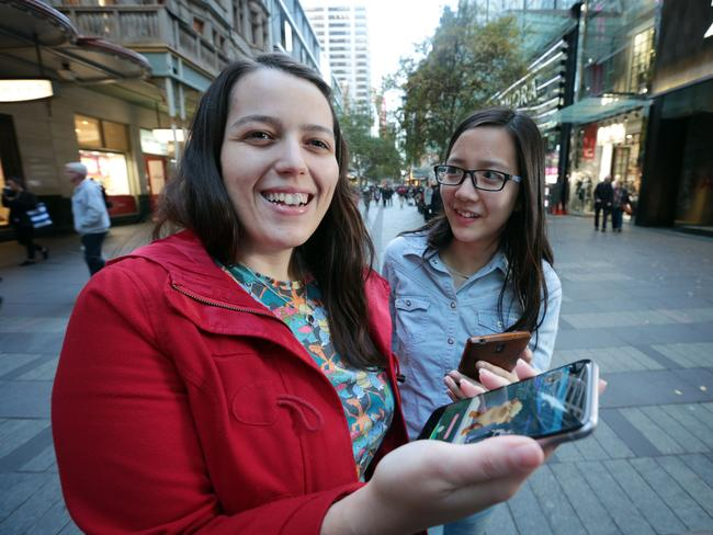 Pokemon Go fans Kelly Vieira and Cerina Djandra in Sydney CBD with their Pokemon app.