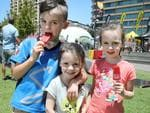 People enjoying the Santos Festival of Cycling in Victoria Square, Adelaide. Ky Hazelhurst, 8, and his sisters, Briella, 5, and Ava, 3. (AAP IMAGE/Dean Martin)