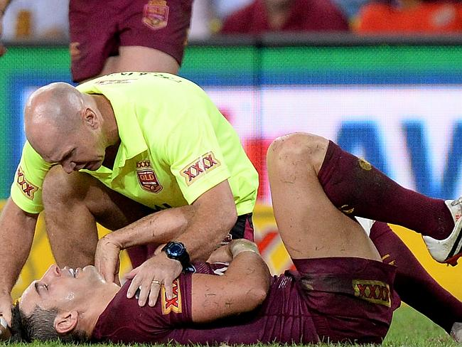 Alfie Langer checks out Billy Slater's injured shoulder.