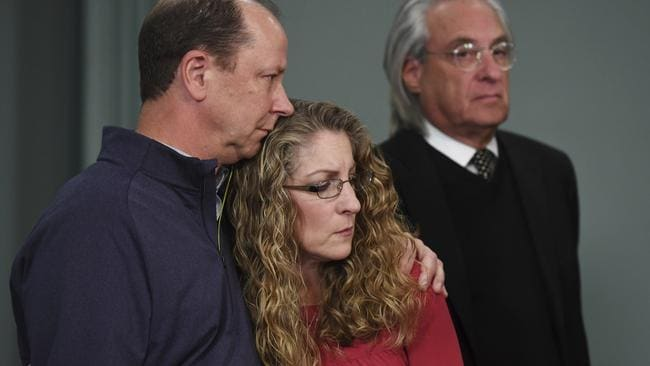 Jim Piazza and Evelyn Piazza held one another as they listened to Parks Miller speak during a new conference regarding new evidence in the investigation into the death of their son. Picture: Phoebe Sheehan/Centre Daily Times/AP